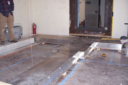 Custom fabricated electrical duct for in-floor wiring at medical facility renovation project